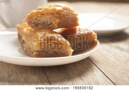 baklava close up on white plate in white background