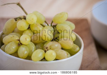 Bunch of grapes close up in bowl in the table