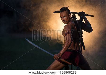 Portrait Ancient warrior man thailand people for background Martial arts concept