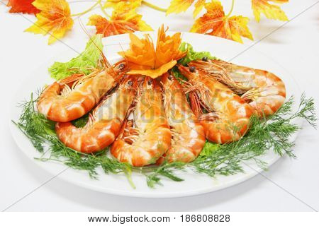 Steamed Shrimp With Cummin Leaves On White Dish