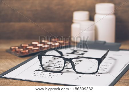 Healthy eyes. Eye chart and medicine. Caring for eye sight by healthy eating.