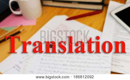 red translation english word over blur working table