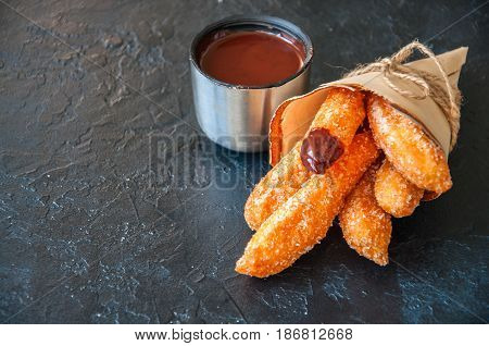 Traditional Spanish Treat. Popular Street Food - Churros Sprinkled With Sugar And Cinnamon Served In