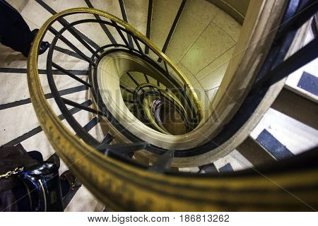 A view of a Spiral staircase. Old yet modern.