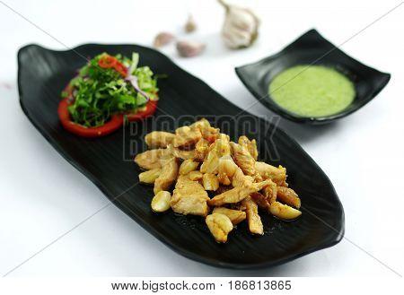 Grilled Boneless Chicken With Garlic And Salad On Black Platter
