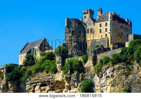 Beautiful Beynac castle standing up the cliff, Dordogne, France