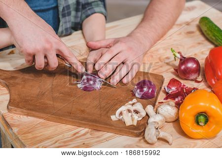 Close-up Partial View Of Father And Son Cutting Fresh Vegetables On Wooden Cutting Board, Dad And So