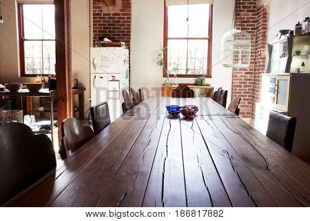 View down dining table top in a loft kitchen dining room