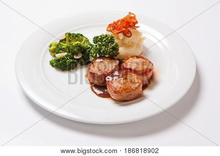 Pork Medallions Wrapped In Bacon, With Potatoes And Broccoli