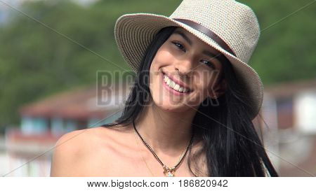 A Cute Hispanic Female Wearing a Hat