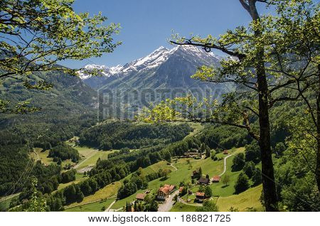 Swiss village in valley near Reichenbach falls (Reichenbachfall) at Swiss Alps, Switzerland