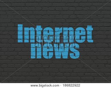 News concept: Painted blue text Internet News on Black Brick wall background