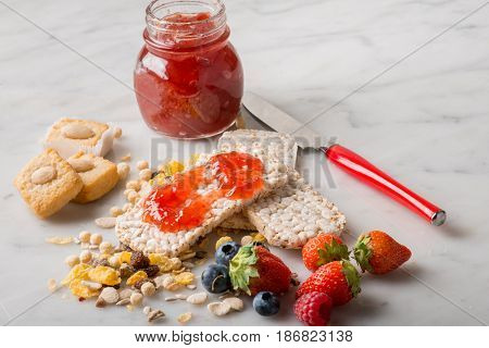breakfast with strawberry jam cookie and fruits