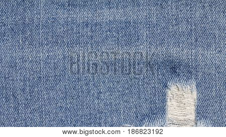 Denim jeans texture, denim jeans background with old torn of jeans fashion design.