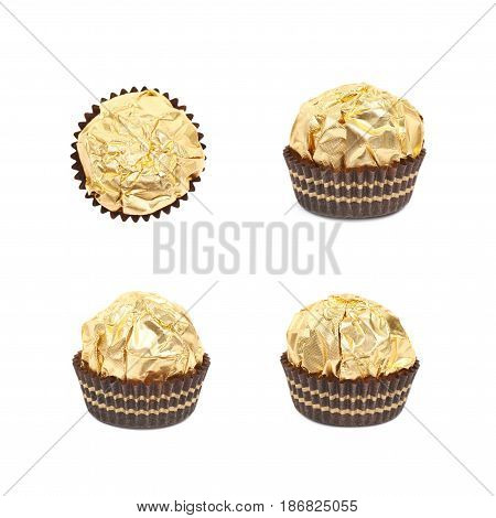 Single confection candy in a golden wrapper isolated over the white background, set of four different foreshortenings