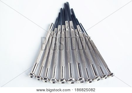 Set of clock screwdrivers on the white background. Closeup