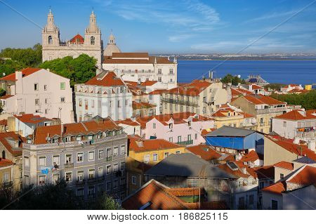 Lisbon city view in the district of Alfama at clear sunny day Portugal