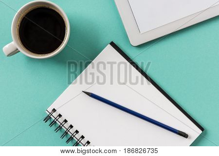 Top View Of Notebook With Cup Of Coffee And Digital Tablet Mock-up, Small Office Home Office