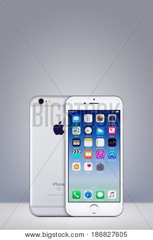 Varna, Bulgaria - March 10, 2016: Silver Apple iPhone 7 with iOS 10 on the screen and back side on vertical gray gradient background with copy space. Quick mockup for your design.