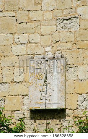 Sundial on side of house for King and God