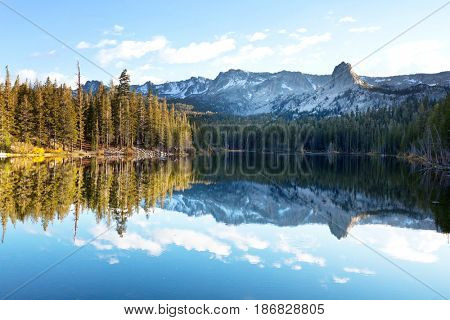 Beautiful nature scene in autumn mountains. Sierra Nevada lake reflection.