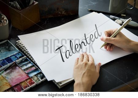 People Hand Writing Talented Skills Word