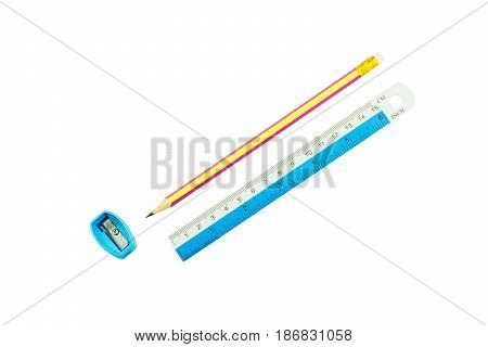Pencil , pencil sharpener and ruler on white background