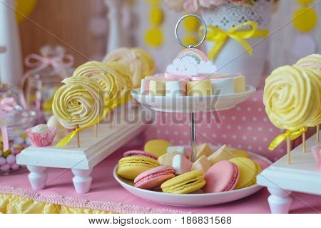 candy bar for first year birthday, candies , cakes on the table