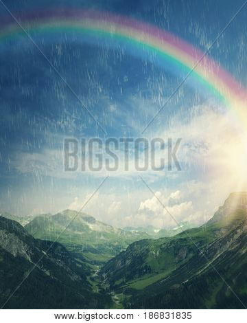Sun and rainbow at the rainy day