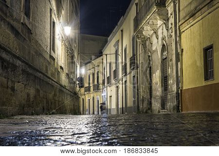 Street In Brindisi By Night With Disappearing Couple, Italy