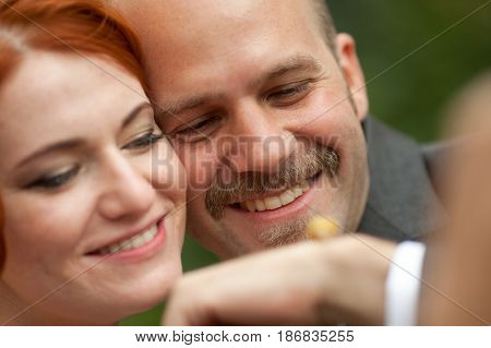 Couple Admires A Snail On The Hand