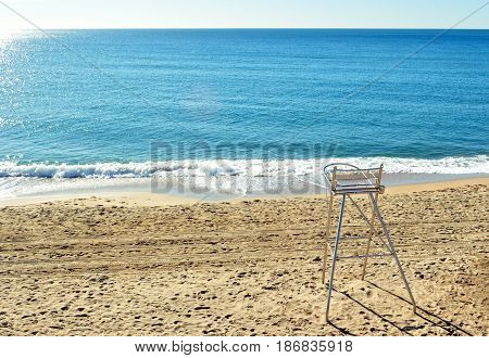 Watchful beach chair in lonely morning with blue sea