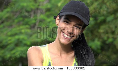 Smiling Female Teenager Wearing a Baseball Cap