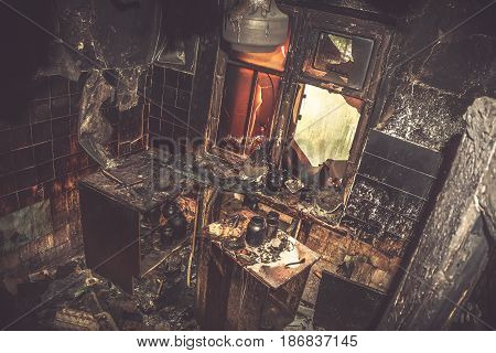 Burned house apartment, interior inside, furniture and utensils, after a big fire, top view