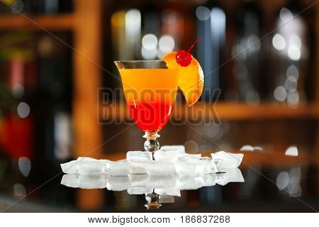 Tequila Sunrise cocktail on bar counter