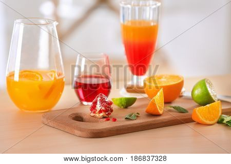 Ingredients for mixing Tequila Sunrise cocktail on table