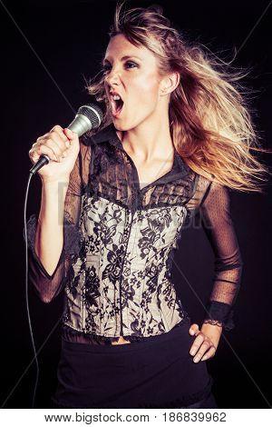 Beautiful blond woman singing karaoke