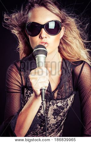 Beautiful rock star woman singing