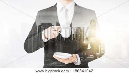 people and business concept - close up of businessman drinking coffee from cup over city with double exposure