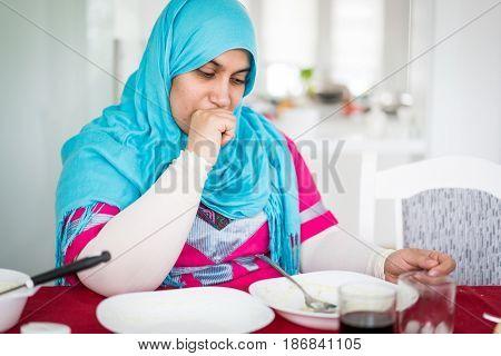 Muslim woman enjoying food in ramadan