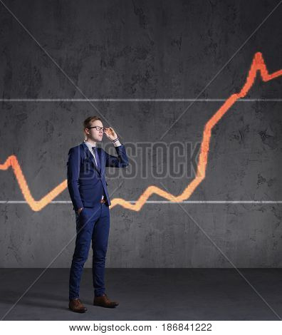 Businessman standing on a diagram background. Business, office, success, concept.