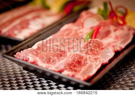 Fresh Raw Sliced Beef With Chili On Black Tray