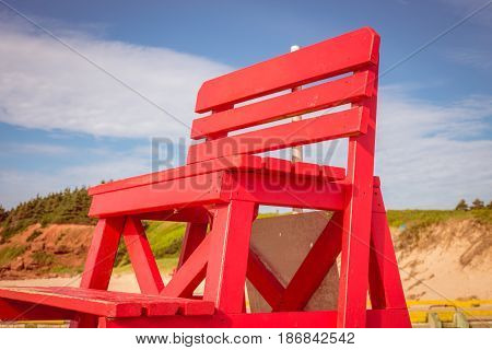 Red wooden lifeguard chair at Basin Head Prince Edward Island