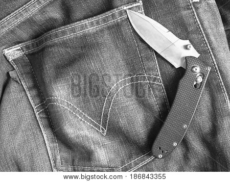 Folding knife put on behind the jean prepare for going out