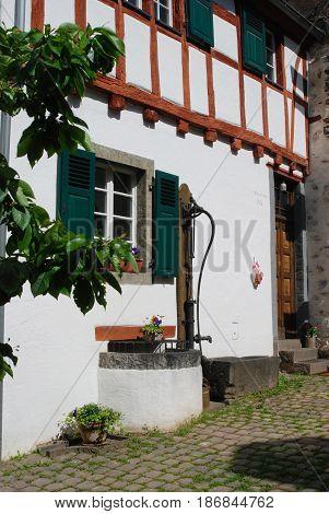 old historic waterpump & woodframed house in Ediger Mosel Germany