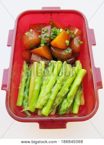 Red Bowl Of Sauteed Carrot, Asparagus And Radish