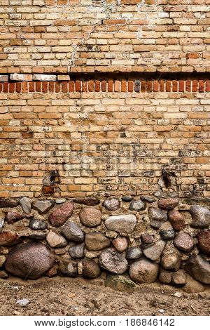 Yellow brick wall background with stone basement