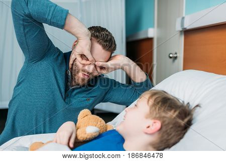 Grimace Dad And Son Having Fun Together In Hospital Chamber