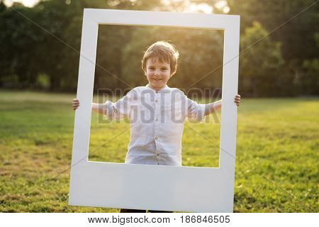 Boy is standing in the park