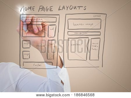 Digital composite of Arm with marker and flare against website mock up and cream background